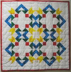 colorful quilt, but no pattern or directions with pin