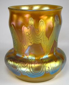LOETZ PHANOMEN GENRE A superb yellow gold and opalescent vase with well controlled combed ribbons in platinum irridescence. Extremely rich. Beautifully signed with Crossed Arrows and Austria in script. Date c1900