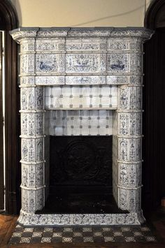 Large antique stove with bleu decor enamels on white background
