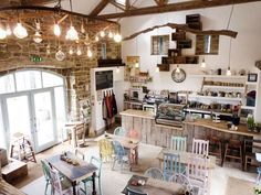 Bivouac Cafe. Gorgeous blend of timber & exposed brick combined with pastel-painted vintage chairs and bare industrial lightbulbs.