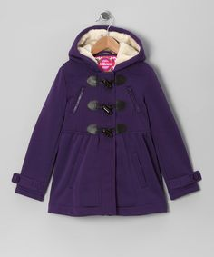 Totally trendy, this coat features a mod design with a fleecy feel on the inside and furry soft lined hood. Practical points like easy toggle closures, hand pockets and diagonal zipper pockets create wear-anywhere versatility that's perfect for a girl on the go. 60% cotton / 40% polyesterMachine wash; hang dryImported