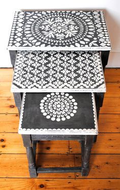 An upcycled vintage wooden table nest. The tables are painted and stencilled using the finest quality Annie Sloan chalk paint. Each table has a different stencil design on the top. All stencils are original designs, hand cut in my studio. Any imperfections should be seen as part of the charm of this one-off original piece. These tables are unique and would make a lovely original addition to your home. Colour: Graphite and Old White Dimensions:Largest Table height 47cms width: 50...