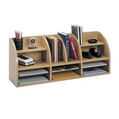 "Essential for your home office or study, this vital organizer keeps desks clear with 12 compartments for pens, notepads, and other supplies.      Product: Desktop organizer    Construction Material: Compressed wood    Color: Oak      Features:   12 Compartments of various sizes     Three adjustable shelves        Dimensions: 15.25"" H x 38.5"" W x 9.625"" DAssembly: Easy assembly required"