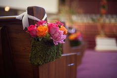 Moss basket aisle marker with pink and orange roses!