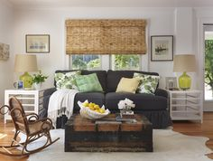 window blinds - a nice mixture of light with specks of dark.  Eclectic living room by Kate Jackson Design