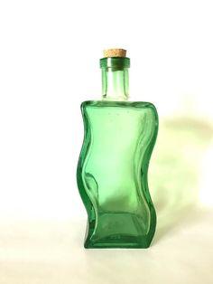 Vintage Curved Green Glass Bottle. Curved Bottle Corked Top. Green Glass Bottles, Flower Vases, Perfume Bottles, Top, Vintage, Decor, Bud Vases, Vase, Perfume Bottle