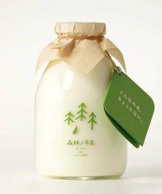 packaging garrafinha de leite com tampinha de papel.