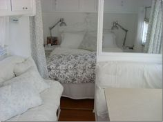 Beautiful inside of trailer - motorhome RV white theme bedroom lamps pillows
