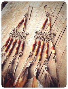 sowelu. chandelier feathered tribal earrings. 'made to order'. $44.00, via Etsy.