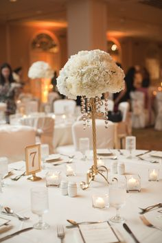 White and gold centerpiece.