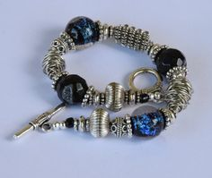 Blue and Black Dicroic Glass Lampwork Beads, Black Druzy Agate, Silver Plated Spacer Beads, and Silver Wire Wrap Beaded bracelet. 8 inches.