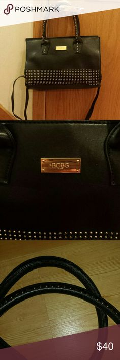 BCBG Studded Bag Leather BCBG Studded black bag with shoulder strap in great condition. Only wear is a little bit on the handles as shown in the 3rd photo. It's an awesome bag with attitude. BCBG Bags