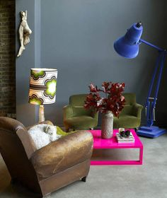 hot pink table with cobalt blue lamp and subdued colors around it  lamp:  ( http://www.anglepoise-inc.com/Products/Giant1227__30383.aspx )
