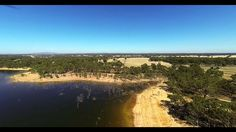Testing the DJI Phantom + GoPro Hero 3 (Lake Eppalock, Victoria) - With Cheap Gimble - Some Jello effect from mount. Needs work. - 1080p X 60fps - Removed fish eye effect - Added Protune video effect - FPV by Boscam 5.8Ghz 200mw (Needs more work) - 8 Inch Carbon Fibre Props (Need 9 Inch Props for extra weight on board) - Requires a GoPro Sun Shade Cover to stop video interferences from props. - Stop Sun Flare on Lens - GoPro