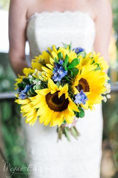 A vibrant bouquet of sunflowers and blue delphinium by Love In Bloom Florist, Key West. Photo by Megan Ellis Photography