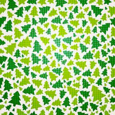 This free seamless Christmas vector pattern has Christmas trees in various shades of green.