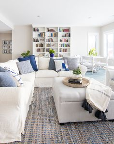 Lake House family room blue and white decor _ slipcovered sectional and chair from Ikea