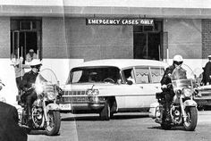 JFK's coffin leaves Parkland Hospital in a white hearse headed to Air Force One at Love Field, on Friday, 11/22/63.   Clint Hill sat with Mrs. Kennedy in the hearse.