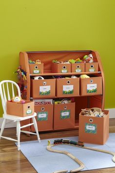 Put kids storage bins close to the ground so they can easily put things away. Get more tips for storing kids toys here: http://www.bhg.com/blogs/better-homes-and-gardens-style-blog/2012/09/08/easy-clean-up-for-your-kids-gear/?socsrc=bhgpin092312kidsorganizingstylespotters