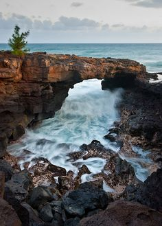 Po'ipu Lava Arch on the island of Kauai, Hawaii.  ASPEN CREEK TRAVEL - karen@aspencreektravel.com