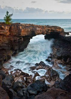 Po'ipu Lava Arch on the island of Kauai, Hawaii.  ASPEN CREEK TRAVEL - karen@aspencreektravel.com