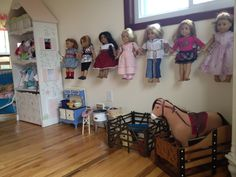 Great way to get American Girl Dolls off the floor! Used a few coat hooks from Target. Right now we just use large command hooks but eventually I'll upgrade to actual wall hooks.