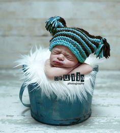 adorable baby in a bucket...blue, must be a boy.