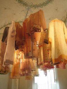 the most interesting alternative I've seen to keeping clothes on a rack: hang them up high & light them like lanterns!