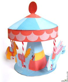 """I did this merry go round to fit in """"Mon Village"""" , my paper toy book published in France ( for the moment). But I made it very cute so you can do it by itslef!     clic on the picture to download a printable pdf    All rights reserved.    Enjoy!"""