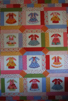 When I saw these dress panels at my LQS, I knew I had to make it for Olivia! The cutest 1 year old in the whole world. Dolly Dress Up, Quilting Board, Doll Quilt, Doll Dresses, Madame Alexander, Applique Patterns, Square Quilt, Quilt Blocks, 1 Year