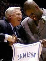 Dean Smith congratulates Antwan Jamison on being the 7th player in Tar Heel history to have his number retired.