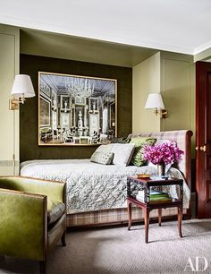 In daughter Kiki's room, a Massimo Listri photograph overlooks an Anthony Lawrence-Belfair bed clad in a Colefax and Fowler plaid; the table is by Alexa Hampton for Hickory Chair, and the carpet is by Stark.