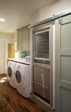 It seems like the designers are finally hearing me. Laundry room with integrated wine fridge. It's the proper way to do laundry. Thank you, Oz Custom Homes.