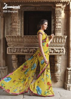 This is beautiful mustard yellow colored saree with marvelous flowery prints.