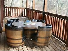 ... level deck with old Jack Daniels whiskey barrel chairs and table