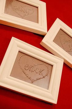 Etch their names in sand and then take photos of them... crop similarly. print, frame, hang. Also a great idea- do the name in the sand photo in black and white print and use as a card for another pressie