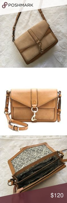 """Rebecca Minkoff Tan Hudson Moto Crossbody Full sized Hudson Moto with tan mixed leather. Has an adjustable strap, a clasp closure, exterior flap pocket, 2 separated interior compartments with an zip pocket and 3 open media pockets. 12""""x3.5""""x8"""". Does have some natural wear. Exposed leather has naturally lightened, leaving the leather under the outside pocket slightly darker but totally unnoticeable during wear. Rebecca Minkoff Bags Crossbody Bags"""