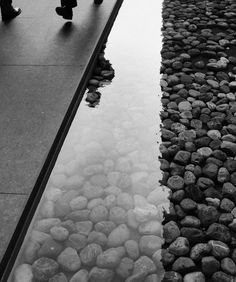 Shallow pool filled with oversized gravel...