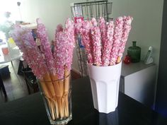 Breadstick with white chocolate and pink dutch sprinkles. A treat for visitors when a baby is born.