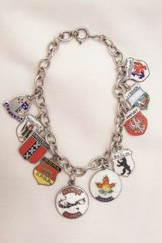 Ruby Red Tag Sale Sale starts Sat Jan 11 8:00 AM, ends Sun Jan 12 8:00 AM Pacific Time. This item will be 50% off the price above during the Sale! Sterling Travel Enamel Shield Bracelet 10 charms most rare