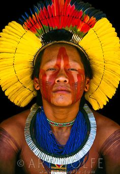 This Kayapo Indian Man, from the southwestern Amazon, is wearing a magnificent headdress of parrot feathers