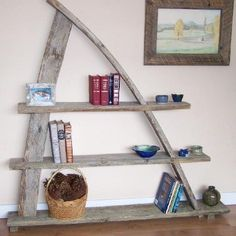 """barnwood, one-of-a-kind book shelf  This one of a kind, handcrafted bookshelf was made with reclaimed fir fence boards. The curved planks were made by mother nature being exposed to the element for decades. It measures at 70""""long x 71"""" high."""