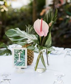 Image result for tall tropical centerpiece