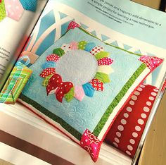 This pillow is in the Winter issue of Quilts and More and coordinates with the Holiday Wreaths quilt in my book for C&T Publishing, Modern Holiday.