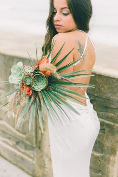 This succulent bouquet is everything!  Photo and Bouqeut by:  Britnee Johnson of Coastal Cactus Photography.