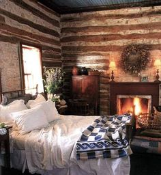 Bed making skills not required!!! I could spend my Sunday here! Love this cozy fireplace! What a beautiful rustic and very old log cabin home. I would love to be in this spot right now!
