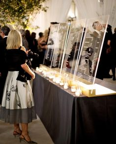 Lucite lent an ethereal quality to the seating chart—as well as the ceremony…