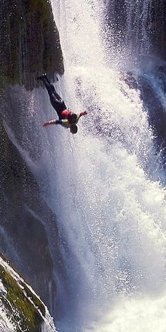 Leaping into a waterfall on the Una River at the Croatia border with Serbia-Herzegovina.