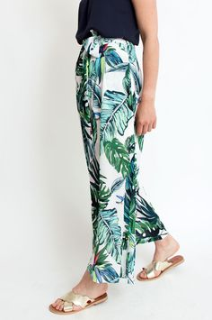 These white trousers give summertime style a glamorous update. The tropical print is shown in yellow, blue and green hues, while the high-rise waist ensures a flattering silhouette. Wear yours with a simple silk top for guaranteed sophistication. From Sienna With Love. Available at Sienna Boutique.