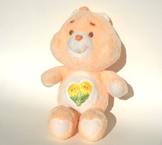 Think i had a grumpy bear when i was a kid, my older sister had the sunshine bear. think my cousin had this bear though.   Care Bear Plush Friend Bear Vintage 1980s Toy by ManateesToyBox, $11.85